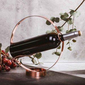 Design Viinipullonpidike kaatotoiminnolla